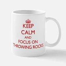 Keep Calm and focus on Throwing Rocks Mugs