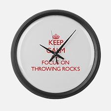 Cute I throw rocks houses Large Wall Clock