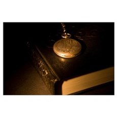 Gold Pocket Watch Resting On A Book Poster