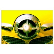 The Grill Of A Yellow Studebaker Car Poster