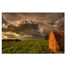 Rolled Hay Bales Under Storm Clouds, Alberta, Cana Poster