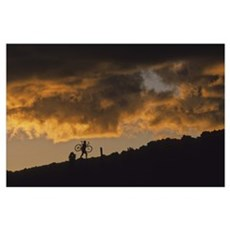 Mountain Biker Carries Bike Up Rocky Slope, Whistl Poster