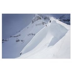 Skier On Crest Of Big Drop, Dwarfed By Mountain, C Poster