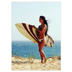 Woman Standing On The Beach With A Surfboard Poster