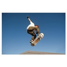 Low Angle View Of Young Male Skateboarder Poster