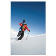 Man Backcountry Snowshoeing While Carrying A Snowb Poster