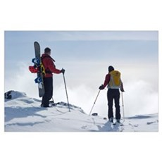 Snowboarder And Skier Enjoy View Above Clouds On E Poster