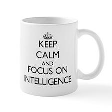 Keep Calm and focus on Intelligence Mugs