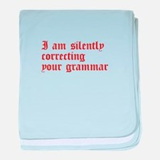 silently correcting grammar-old red baby blanket