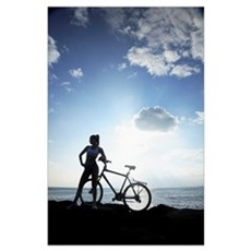 Hawaii, Oahu, Silhouette Of A Woman With A Bike On Poster
