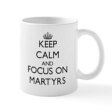 Keep Calm and focus on Martyrs Mugs