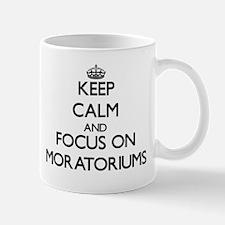 Keep Calm and focus on Moratoriums Mugs
