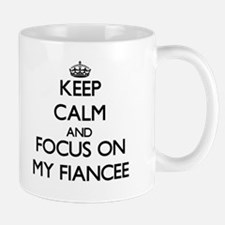 Keep Calm and focus on My Fiancee Mugs
