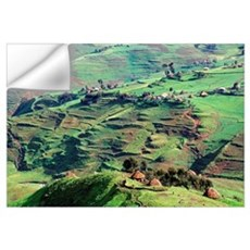 Huts Along Green Hilly Landscape Wall Decal