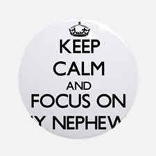 Keep Calm and focus on My Nephews Ornament (Round)