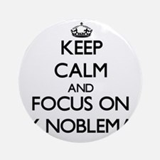 Keep Calm and focus on My Noblema Ornament (Round)