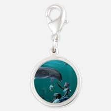 Dolphin playing Charms