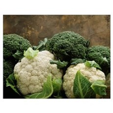 Broccoli crowns and cauliflower heads on marble Poster