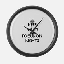 Keep Calm and focus on Nights Large Wall Clock