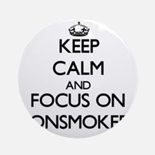 Keep Calm and focus on Nonsmokers Ornament (Round)