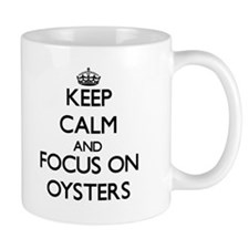Keep Calm and focus on Oysters Mugs