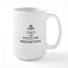 Keep Calm and focus on Prescriptions Mugs