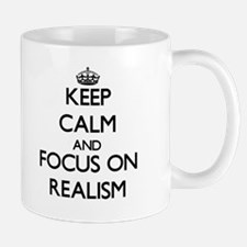 Keep Calm and focus on Realism Mugs
