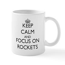 Keep Calm and focus on Rockets Mugs