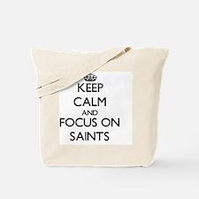 Keep Calm and focus on Saints Tote Bag
