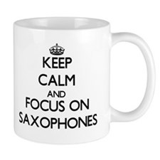 Keep Calm and focus on Saxophones Mugs