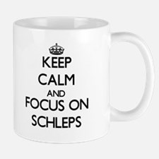 Keep Calm and focus on Schleps Mugs