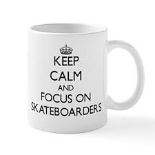 Keep Calm and focus on Skateboarders Mugs