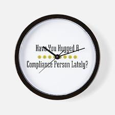 Hugged Compliance Person Wall Clock