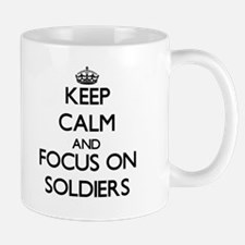 Keep Calm and focus on Soldiers Mugs