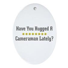 Hugged Cameraman Oval Ornament