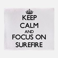 Keep Calm and focus on Surefire Throw Blanket