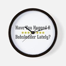 Hugged Bobsledder Wall Clock