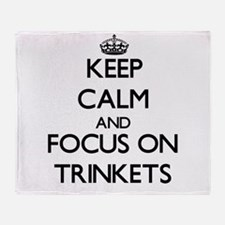 Keep Calm by focusing on Trinkets Throw Blanket