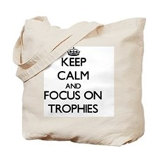 Keep Calm by focusing on Trophies Tote Bag