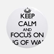 Keep Calm by focusing on Tug Of W Ornament (Round)