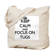 Keep Calm by focusing on Tugs Tote Bag
