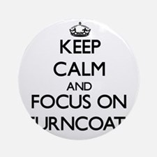 Keep Calm by focusing on Turncoat Ornament (Round)