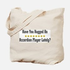 Hugged Accordion Player Tote Bag
