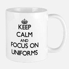 Keep Calm by focusing on Uniforms Mugs