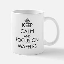 Keep Calm by focusing on Waffles Mugs