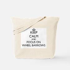 Keep Calm by focusing on Wheel Barrows Tote Bag