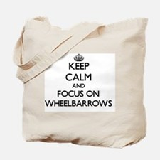 Keep Calm by focusing on Wheelbarrows Tote Bag