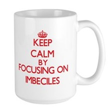 Keep Calm by focusing on Imbeciles Mugs