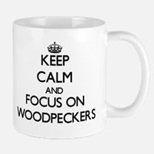 Keep Calm by focusing on Woodpeckers Mugs