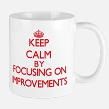 Keep Calm by focusing on Improvements Mugs